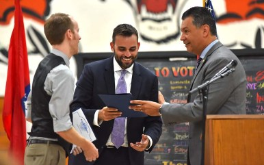 """Secretary of State Alex Padilla presents certificates of recognition to Nate Powell (left) and ) Andrew Aydin, artist and co-author of """"March."""""""