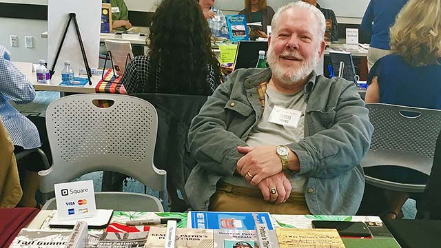 Mike Province, who worked 36 years at The San Diego Union-Tribune, sells his books at 2017 Oregon City Author Fair.