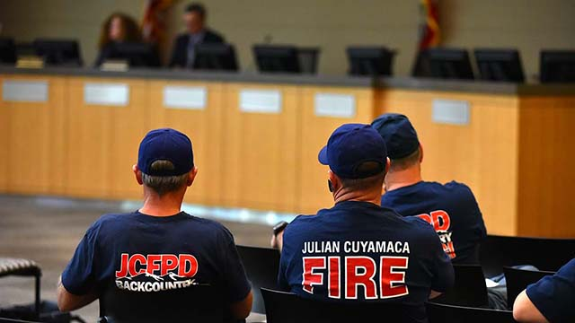 Julian volunteer firefighters listen to LAFCO protest hearing on their district's dissolution.