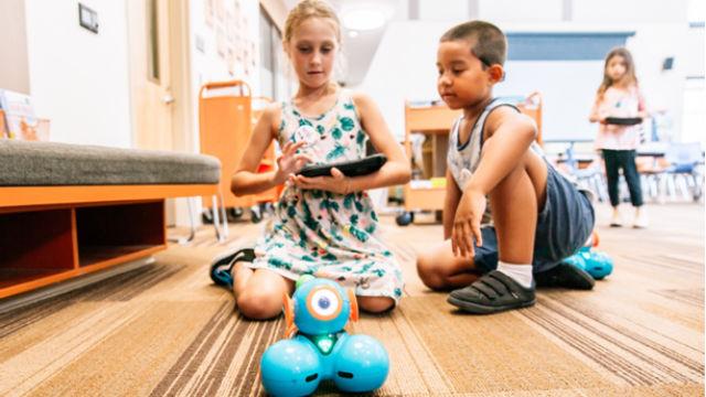 School children programming a robot