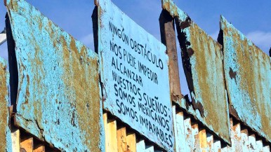 """A sign saying in Spanish, """"No obstacle can prevent u from reaching our dreams. We are Mexicans, we are unstoppable"""" was painted on the Mexican side of the border fence."""