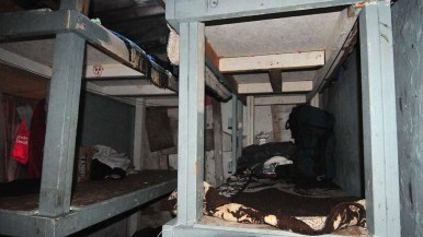 Migrants sleep on bunk beds in a shelter in Tijuana near the Mexican border.