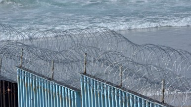 Two rows of concertina wire were recently added to the border fence after some people sat atop it last week.