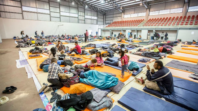 Central American migrants at a sports facility in Tijuana