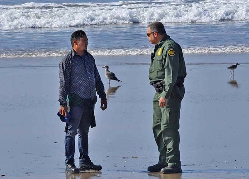 A man with a soaking wet polka dot shirt and tore jeans and sweater walked around the border fence and was intercepted by a Border Patrol supervisor.