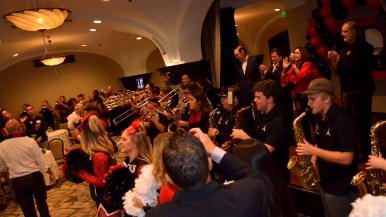 With SDSU President Adela de la Torre clapping along, the Aztec Pep Band celebrates passage of Measure G.