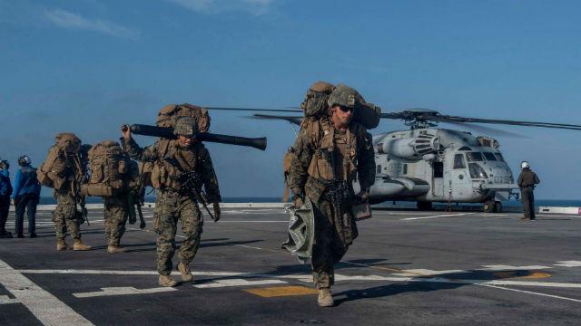 Marines on the flight deck of the USS Somerset