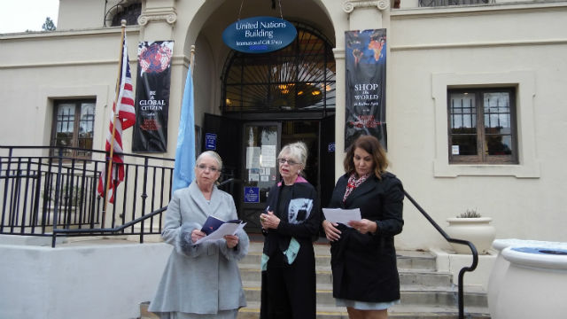 Activists read from the Universal Declaration of Human Rights