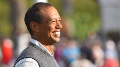 Tiger Woods smiles after first round of Farmers Insurance Open.