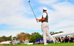 Tiger Woods watches shot at Farmers Insurance Open.