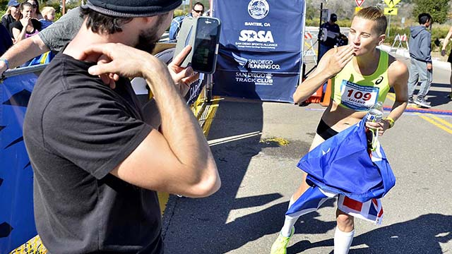Claire Tennant blows a kiss to phone after winning the Waterbridge Capital International 50km Challenge at Santee.