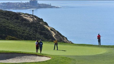 Justin Rose putts on the 3rd hole on the edge of the Pacific Ocean during the Farmers Insurance Open in La Jolla.