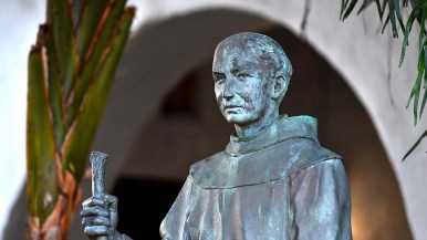 A statue of Fr. Junípero Serra stands in the garden in the mission's courtyard.