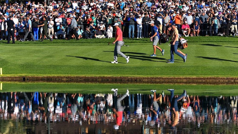 Jon Rahm and Justin Rose head to the green of the 18th hole on the final day of the Farmers Insurance Open.