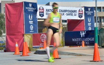 Claire Tennant is a blur as she passes the portable start-finish line, demonstrating straight leg action.