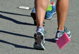 Race walkers were given sponges to splash themselves on a day when temps soared to the early 80s.