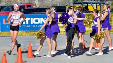 Nick Christie passes a gaggle of Santana High School cheerleaders several hours into 50K race.