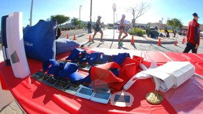 Age-group medals await finishers as Nick Christie leads eventual winner David Velasquez at northern turn.