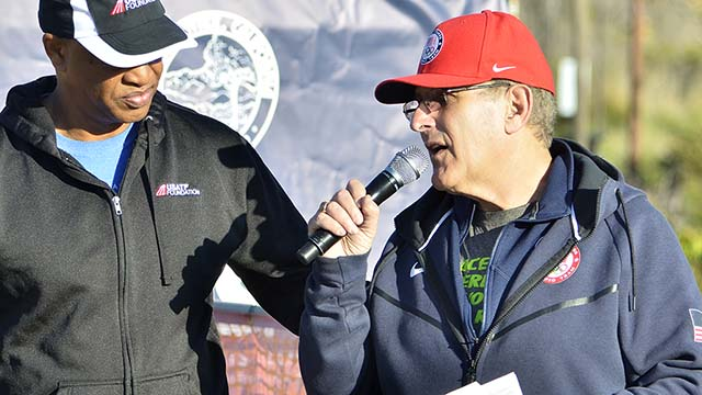 Tracy Sundlun (right) is still deeply involved in sports, such as the USATF National 50K Race Walk Championships last week in Santee, where he interviewed Olympian Willie Banks.