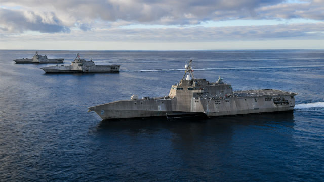 Three littoral combat ships in formation