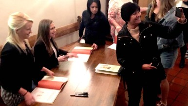 Chelsea Clinton autographed her fifth published book and posed for pictures in the Shiley Theatre foyer after her talk.