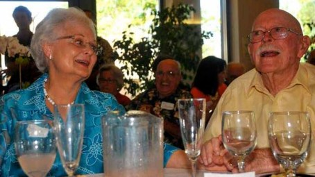 Linda and David Pain savor speakers at his 90th birthday party in 2012.