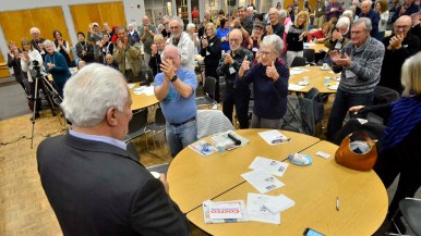 La Mesa-Foothills Democratic Club members applaud Ted Leitner after politically charged remarks.