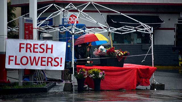 Winds blew off the tarp over a flower booth on Valentine's Day downtown.