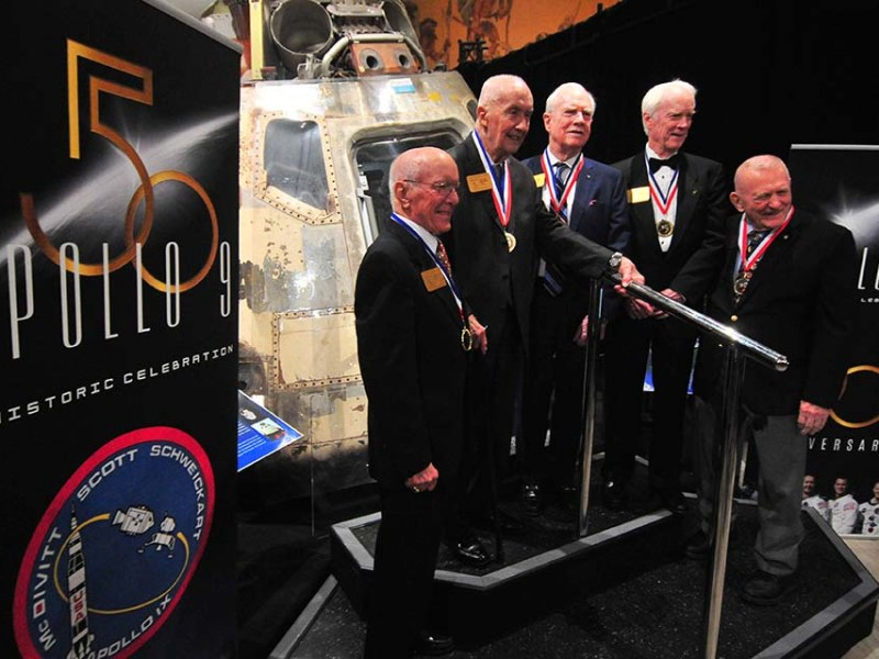 Standing with the Apollo 9 command module in San Diego: a rare reunion of five team members (from left) Gerry Griffin, Jim McDivitt, David Scott, Rusty Schweickart and Gene Kranz.