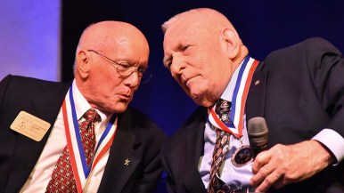 Fellow NASA veteran leaders and flight directors Gerry Griffin (left) and Gene Kranz lean in during interview phase.