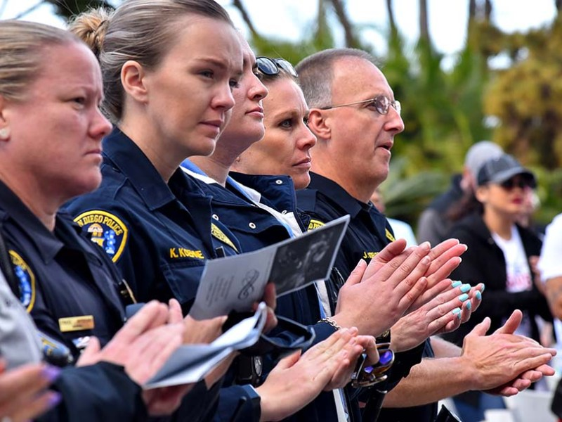 Members of the San Diego Police Department participated in the prayer vigil for homeless people who died in the county.