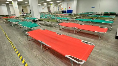 One hundred fifty cots are ready for the influx of asylum seekers bused in by the Customs and Border Protection.