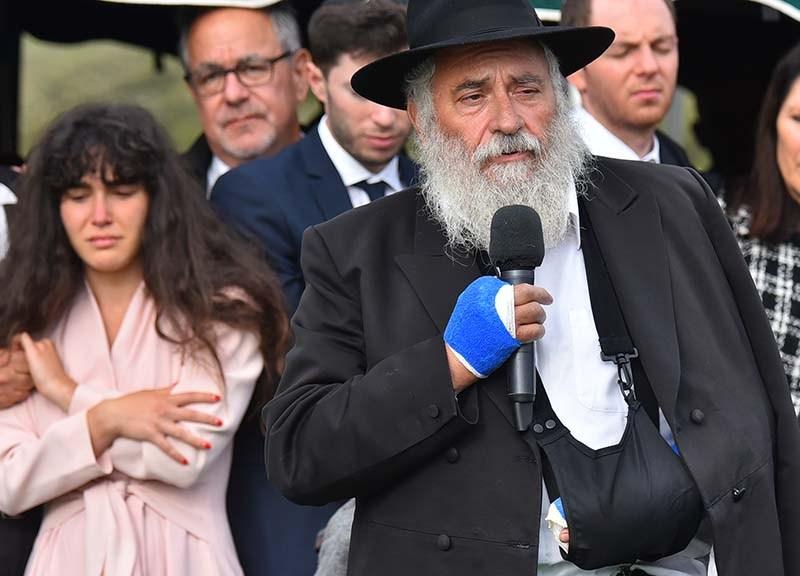 Chabad of Poway Rabbi Yisroel Goldstein speaks to those gathered at the gravesite of Lori Kaye at El Camino Memorial Cemetery.