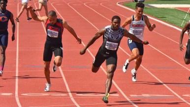 Kenan Christon of Madison High School wins a 100m heat in 10.62.