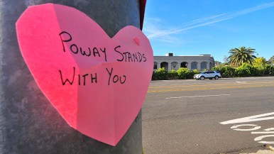 A neighborhood family placed hearts with supportive messages across the street from Chabad of Poway.