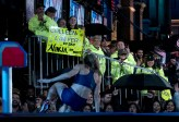 """Colleen Barney exits the """"ANW"""" stage toward her fans after falling on the Shrinking Steps first obstacle at March 7 Los Angeles trials"""