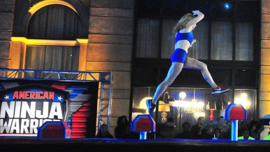 """Colleen Barney nears the fourth step on the opening obstacle of """"American Ninja Warrior."""""""