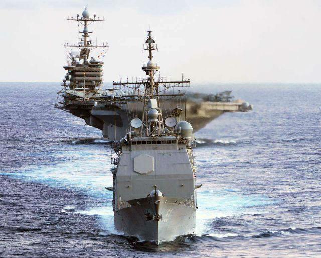 USS Mobile Bay leads the USS John Stennis
