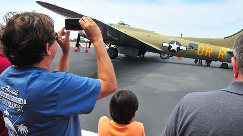 About 100 fans of vintage military airplanes got a close-up look for five planes at McClellan-Palomar airport in Carlsbad.