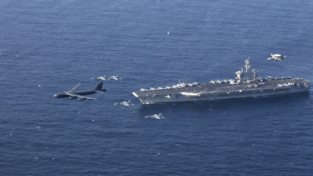 B-52H flies over USS Abraham Lincoln