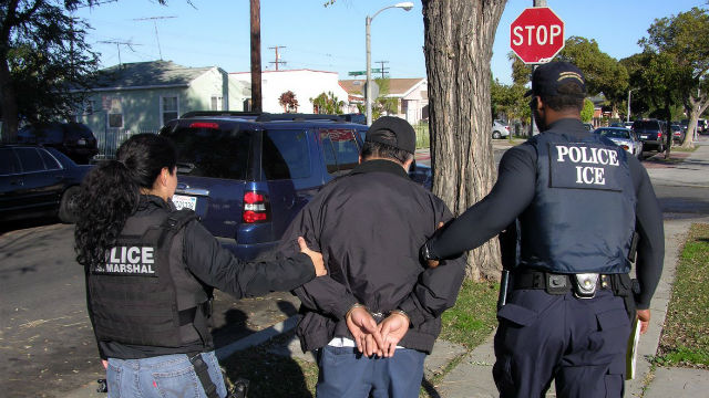 ICE agents arrest an immigrant man