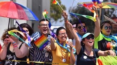 Parade goers show their enthusiasm for parade participants.