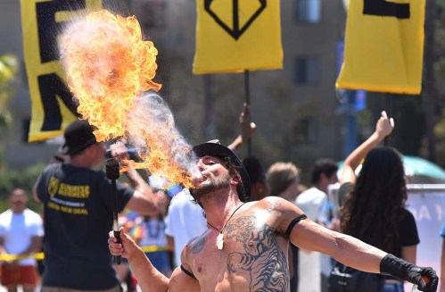 A fire-breathing performer for KNSJ Radio delighted the onlookers on the San Diego Pride Parade route.