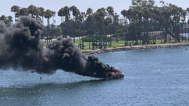 Flames from burning boat off Dana Landing.