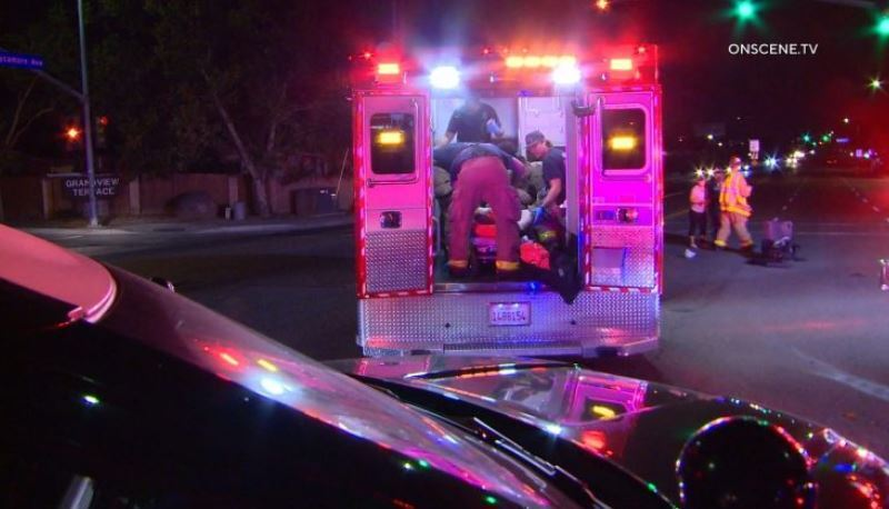 Injured man treated in an ambulance