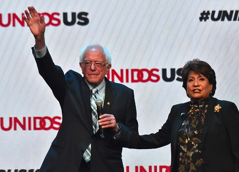 Sen. Bernie Sanders alongside president and CEO of UNIDOS US Janet Murguía greets Hispanic leaders at their annual conference at the San Diego Convention Center. Photo by Chris Stone