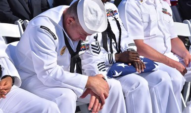 A member of the Strategic Weapons Facility, Pacific in Washington listens to a speech at the 18th annual 9/11 USS Midway Memorial Service. Photo by Chris Stone