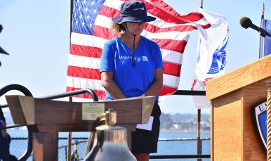 An employee from United Airlines stood in honor of New York Port Authority personnel who died on Sept. 11, 2001. Photo by Chris Stone