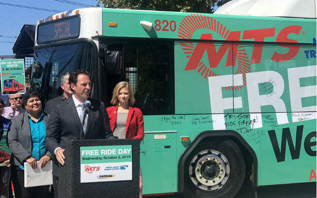 Supervisor Nathan Fletcher in front of a bus