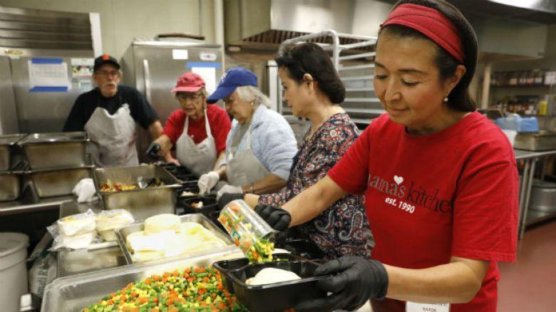 Preparing meals at Mama's Kitchen.